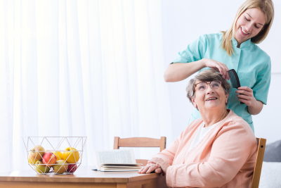 Image of caregiver take care of senior patient