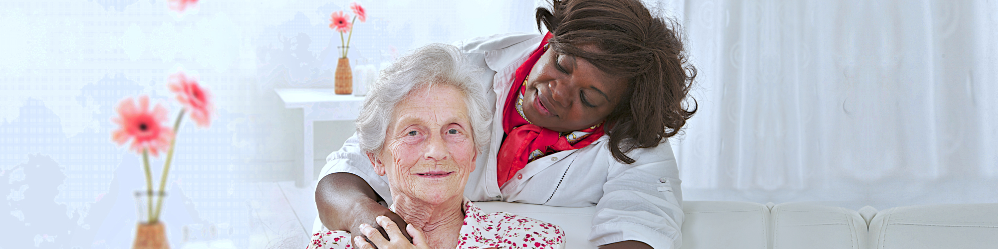 the nurse holding a hand of senior woman